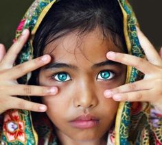 Love the focus of her eyes in this photo and the way she has placed her hands near her face. So there is no doubt where you should be looking - her stunning eyes!