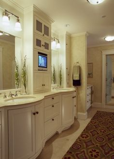 TV in cabinet - this could work for getting ready and for either the tub or shower in our bathroom