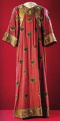 A robe she wore and saved. The unfaded red alone is uniquely rare, all hand made, the cloth, the embroidery.  Medieval European tunic, Chinese red damask, c. 1300; gold and silk embroidery