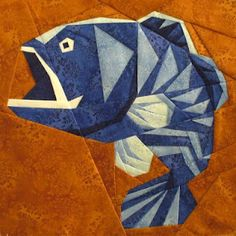 Kathy's Quilts has an amazing paper pieced fish block