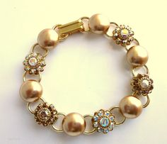 swarovski crystal and pearl bracelet gold with by siggysbeads, $45.50