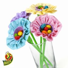 Learn how to transform a bouquet of flowers with duct tape and plastic Easter eggs in this craft from Duck® brand. http://duckbrand.com/craft-decor/activities/easter-egg-flower?utm_campaign=dt-crafts&utm_medium=social&utm_source=pinterest.com&utm_content=duct-tape-crafts-spring
