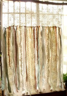 This shabby Chic garland curtain shows pure elegance, French farmhouse,romance and has a ROMANTIC SHABBY CHIC BOHO Gypsy Victorian theme feel, really makes a statement! This unique garland curtain is hand made with vintage lace textile with hand tied with various of TATTERED new and vintage fabric,laces and pink rosettes!  It comes with top jute ties so that you can tie this to rod easy.  Limited vintage textile qty,once sold out,no more available.  Shades of soft pastal…
