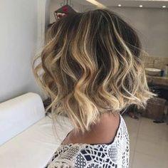 Wavy Dark Short Bob Haircut with Honey Blonde Balayage Highlights