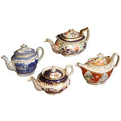 England  19th c.  A collection of early English teapots, c.1800-1820, featuring hand-painted designs and gilt accents.