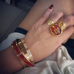 Cartier love + hermés beacelets+ YSL ring. pretty stack
