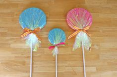 I think layers of cardboard will be cheaper but I like the idea of gettting colors from Tissue paper!  Glorious Treats » {How-to} Make Giant Lollipop Decorations