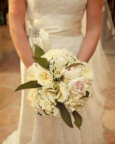 Unique Bouquet, This bouquet of light-pink peonies and white garden roses is accented with an unexpected element -- decorative kale.