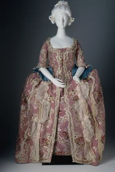 Pink floral silk brocade gown trimmed with pleated linen bands, looped silk ribbon, and glass pearl beads, American, 1765-1775.