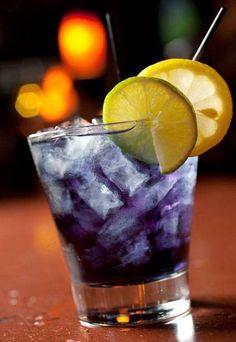 Purple People Eater: 1 1/4 oz. Captain Morgan 1/2 oz. blue Curacao Splash cranberry juice Splash Sprite Splash pineapple juice Lemon garnish.