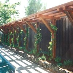 w/ an overhang and greenery as walkway to garage?