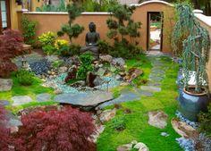 statue de boudha en jardin coloré