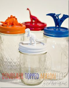 How to make dinosaur topped mason jars with plastic dinosaurs and spray paint. Mason jar craft for kids. Includes how to tutorial. Mason Jar Projects, Mason Jar Crafts, Mason Jars, Dinosaur Birthday Party, Birthday Crafts, Birthday Recipes, Crafts For Boys, Fun Crafts, Plastic Dinosaurs