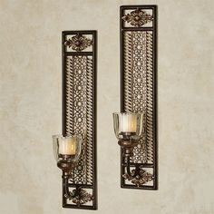 The Charleston Hurricane Wall Sconce Pair adds a refined presence to your space. Metal wall sconces are finished in bronze with gold highlights.