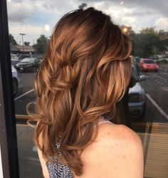 This pretty, rose gold balayage hair color by @adrianbillot adds gorgeous dimension to @coco_shrimp's curly, layered haircut. Aveda color formula in the comments.