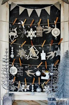 Make your own advent calendar with an ornament a day. A fun way to celebrate the days leading up to Christmas! Clip ornaments onto twine on a chalkboard.