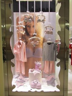 Darling lingerie window displays I love the ribbon and bows! These ribbon bows can be clubbed with tungsten bulbs so that every product gets light and light is not a problem at all. Use the bra bag for since bras cannot be displayed. Visual Merchandising Displays, Visual Display, Boutique Decor, Boutique Design, Shop Window Displays, Store Displays, Lingerie Store Design, Lingerie Stores, Underwear Store