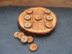 tic tac toe on a wood slice.: