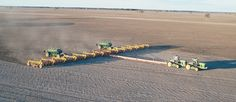 Zell Gavin's 212 foot air seeder takes a pair of Deere 9Ts to keep it rolling. Twin Simplicity air carts feed the system.
