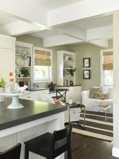 Built-in shelves are a great way to softy transition a kitchen desk into the family room or sitting room.