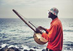 Musician playing kora, Senegal