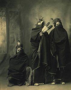 In Winter, Kiowa (Sitting at the left - Ah-Keah-Boat (aka Jim Two Hatchet), by Frank A Rinehart, 1898