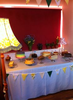 Wedding cake table rainbow cake battenberg village hall