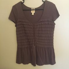 Anthropologie Peplum Top! Cute purple peplum top with shimmery stitching down the front. Anthropologie Tops Tees - Short Sleeve