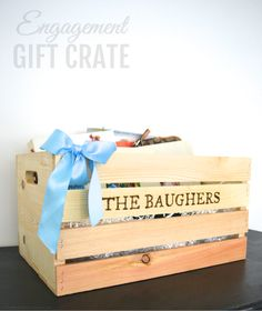 Greatest Story Weddings | A Custom-crafted Wood-Burned Engagement Gift Crate filled with Wedding Books, Magazines, Wine, and Wood-Burned Picture Frames