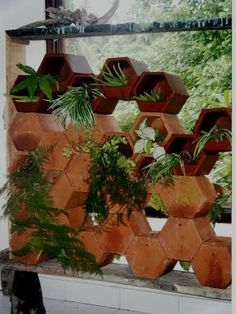 Designers at the Bali Ecological Center drew inspiration from giant wasp nests to create this charming green wall. The modular vertical garden is made from terracotta by skilled local craftsmen in Bali. Plants can be exposed in both directions, and the planter can be arranged according your tastes or needs. The Bali Eco Green Wall provides additional green space indoors or out, while functioning as a space partition, light screen, or standard wall. #garden #eco #design #thumbsup