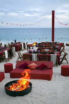 A firepit awaits wedding guests on the beach.