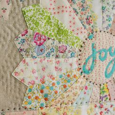 joy stitches by nanaCompany, via Flickr words in the center, maybe machine embroidery?