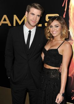 Liam Hemsworth and Miley Cyrus arrive at the premiere of Lionsgate's 'The Hunger Games' at Nokia Theatre L.A. Live on March 12.