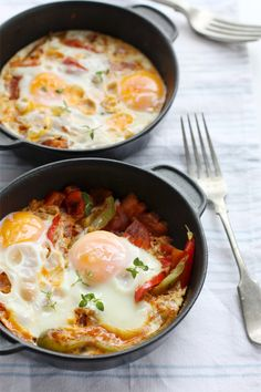 This looks like its right up my alley:)Shakshuka Eggs - A spicy breakfast egg dish cooked with two different kinds of chili for the perfect pick-me-up!