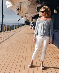 Stylish daytime Caribbean cruise outfit. Follow @midlifeinbloom on Instagram for more style tips and ideas.  #caribbean #celebritycruise #resortwear #whitepants #travelblogger #travelblog #offtheshoulder #styleinspiration #tansandals #styleideas #womensoutfits #styleover50 #caribbeancruise #cruiseblogger #travelfashion Cruise Outfits, Vacation Outfits, Yacht Party, Family Cruise, Caribbean Cruise, Fashion Over 40, White Pants, Resort Wear, Travel Style