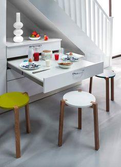 L'exploitation d'un coin séparé de l'espace principal est une bonne façon de concilier cuisine ouverte et fermée. À l'exemple de ce modèle (Vega Artic Wood de Cuisinella), qui joue la