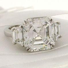 Vanessa Minillo's three-stone diamond ring featuring a four-carat Asscher-cut center stone set in platinum