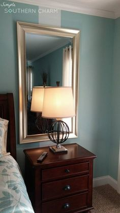 Add large mirrors behind night stands to create the illusion of more light... | Simple Southern Charm