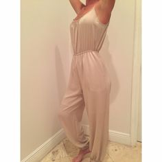 Beige Jumpsuit Plan beige jumpsuit with spaghetti straps and cinched waist Naked Zebra Other