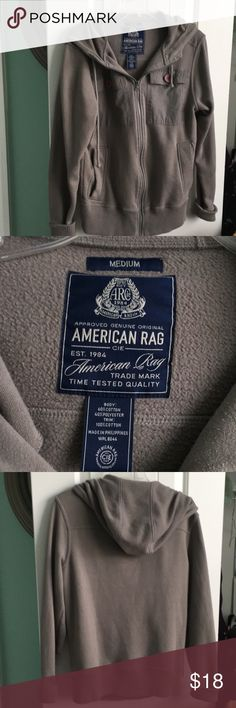 American Rag hoodie jacket It is light gray zipper front two big pockets at top and two at bottom. It has a hood on the back. Nice jacket. Comes from smoke and pet free home. Thanks for looking. American Rag Jackets & Coats
