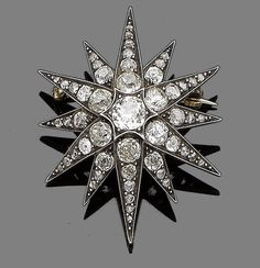A diamond star brooch/pendant, circa 1890.  The twelve-rayed star, set throughout with cushion-shaped and rose-cut diamonds, the largest to the centre, mounted in silver and gold, diamonds approx. 3.20cts, detachable brooch fitting, length 4.3cm
