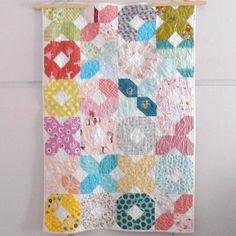 Modern patchwork XOXO baby crib size quilt multicolor by nenimav