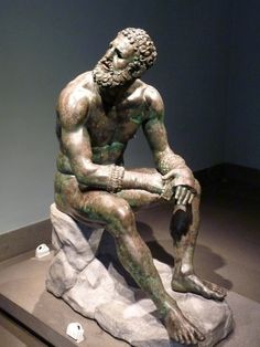 Bronze statue of a boxer, dated around BC. This Greek piece of art is currently displayed at the National Museum of Rome. The striking face of the boxer shows the realities of what he endures, and the beard tells us that this was an adult's game. Roman Sculpture, Bronze Sculpture, Lion Sculpture, Ancient Romans, Ancient Art, Rome Museums, Alexandre Le Grand, Greek Statues, Buddha Statues