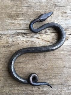 These amazing little snakes have been hand forged out of steel and formed into a new twist on the traditional S hook. Use a whole line of them for a truly stunning chain or mix just one snake into a l