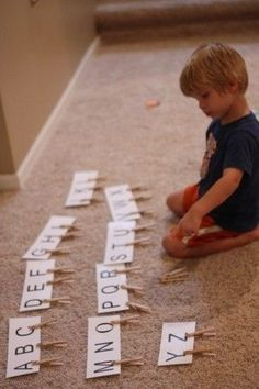 lower case letters written on clothespins, match to upper case cards. -great for fine motor skills too! by angelia