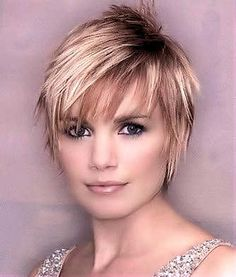 long layered pixie cut, ultra trendy look.