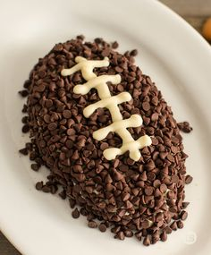 Chocolate Chip Football Cheese Ball Recipe │Be ready for game day with this chocolate chip malt football shaped cheese ball. Serve with twisty grahams, vanilla wafers, pretzels or fruit.