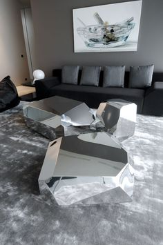 Mirrored rock coffee tables.