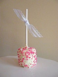 How to Dress Up a Marshmallow: Dipped in white chocolate and pink pearlized sprinkles. #Marshmallow: