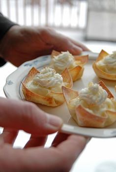Coconut Cream Pie Cups - The best dessert I've made all year! Custard-like filling in baked wontons, topped with coconut whipped cream and toasted coconut.